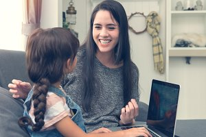 mom and daughter using notebook