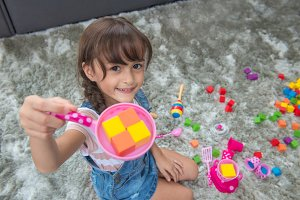 child girl playing with colorful toy