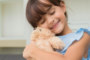 child girl playing with Teddy Bear