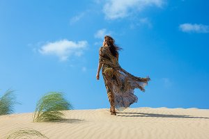 Beautiful Woman on the Sand Dune.