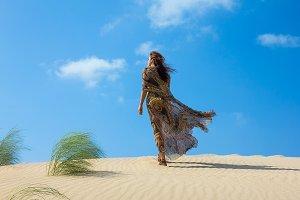 Beautiful Woman on the Sand Dune.