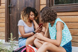 young friends with the mobile outdoor holiday