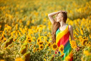 Girl in the yellow field of sunflowers.
