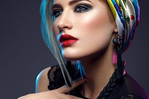 Beautiful girl with bright make-up and shawl on head