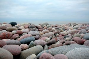 Stones and sand on the seashore.