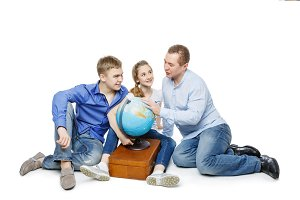 father with children looking at earth globe