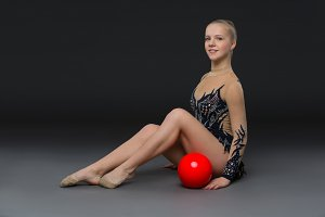 Gymnastist girl with red ball