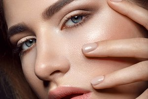 Beautiful girl with natural make-up and manicure