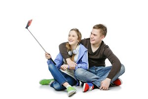 Teen boy and girl taking selfie photo