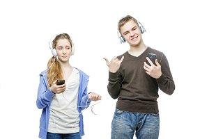 Teen boy and girl with headphones