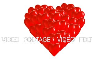 Red balloons in heart shape