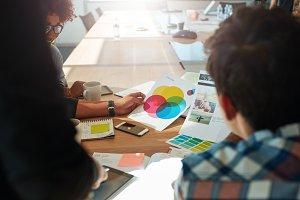 Team brainstorming in meeting room