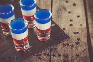 Independence day concept - flag coloured short cocktails on rustic background