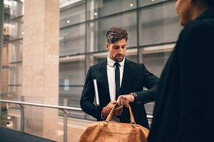 Businessman at airport with bag