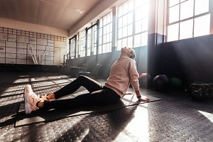 Young woman exercising in gym.