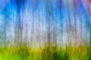 Vertical bokeh blurred abstract landscape with light leak backgr