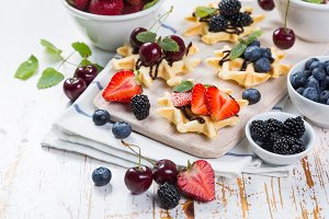 Colorful waffles with different berries