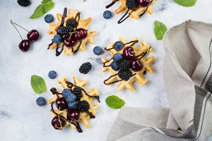 Homemade waffles with chocolate and berries