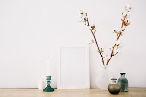 Blank photo frame and cotton branch