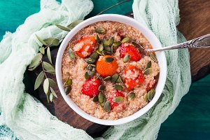 Quinoa porridge with strawberries in bowl