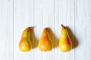 fresh organic pears on table