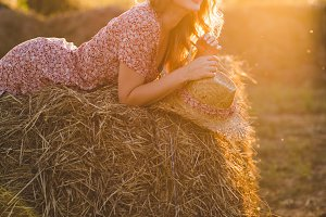 Beautiful woman on a haystack