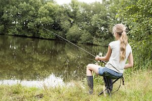 Girl fishing at lake
