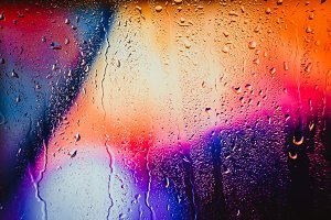 Raindrops on a blurred multicolored background