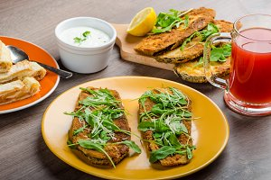 Breaded eggplant parmesan and arugula