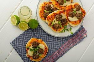Mini pizza with meatballs