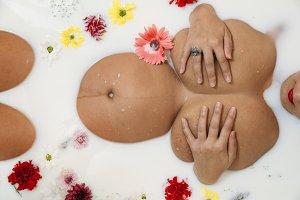 Pregnant woman's body in milk