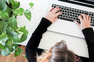Plant, Girl Typing -Styled Photo
