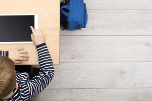 boy using tablet at school