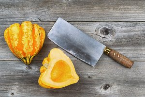 Freshly cut squash with large knife