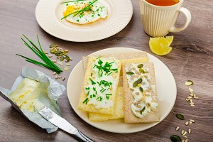 Crisp Crispbread with cheese spread with chives and Crisp Crispbread with curd cheese spread chives and seeds
