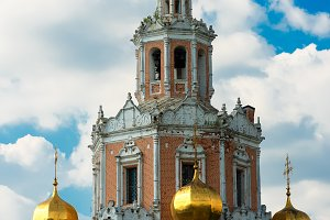 Vertical orthodox church in Moscow backdrop