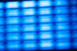 Diagonal blue grid  bokeh background
