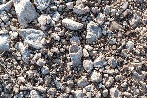 gravel with strange stone in center