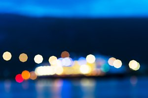 Norway night ship with lights bokeh background