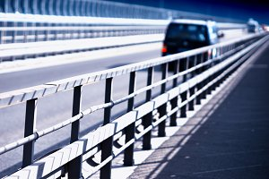 Car on Norway bridge perspective background