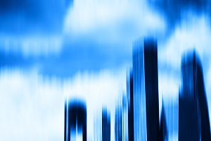 Blue motion blur skyscrapers abstract background