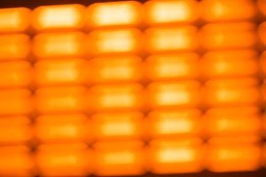 Diagonal orange grid  bokeh background