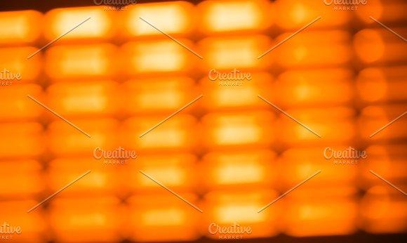 Diagonal Orange Grid Bokeh Background