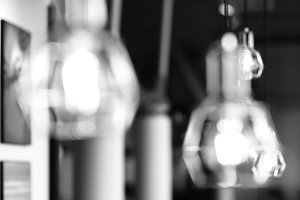 Horizontal black and white cafe lamp bokeh background