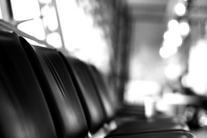 Black and white airport seat with bokeh backdrop