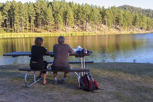 Couple Relaxing At Lake