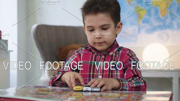 Kid Boy Look And Examine Book With Color Pictures With Interest And Fantasy Playing Miniature Toys