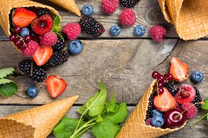 Selection of berries in ice cream cones - healthy dessert concept