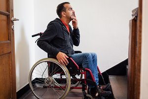 Man In Wheelchair Having Trouble With Stairs