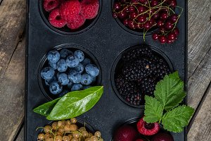 Selection of berries in cupcake form - healthy dessert concept
